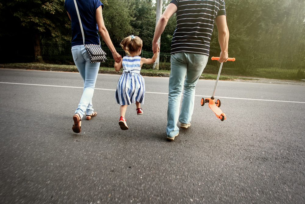 Child and parents crossing street
