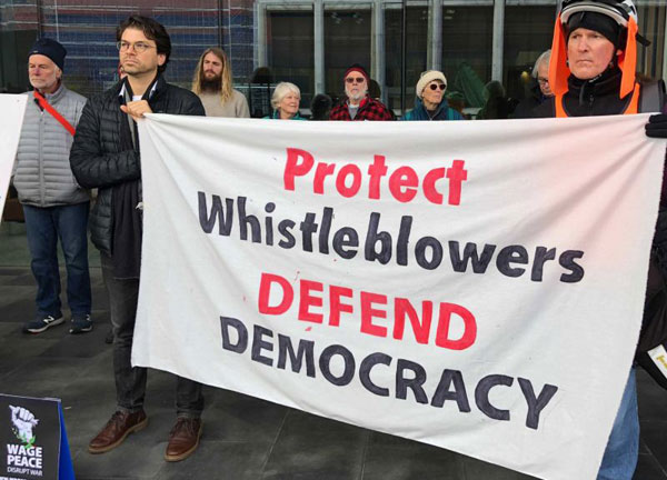 mcbride protest banner with tim hollow