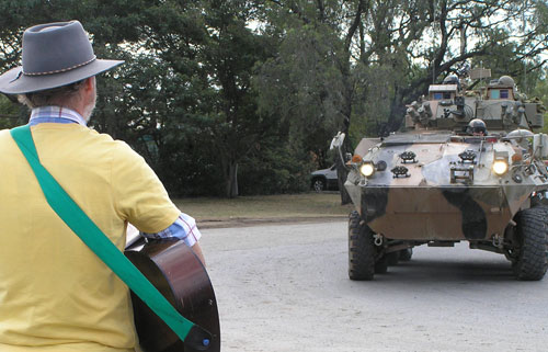Ross Parry sings to armoured vehicle
