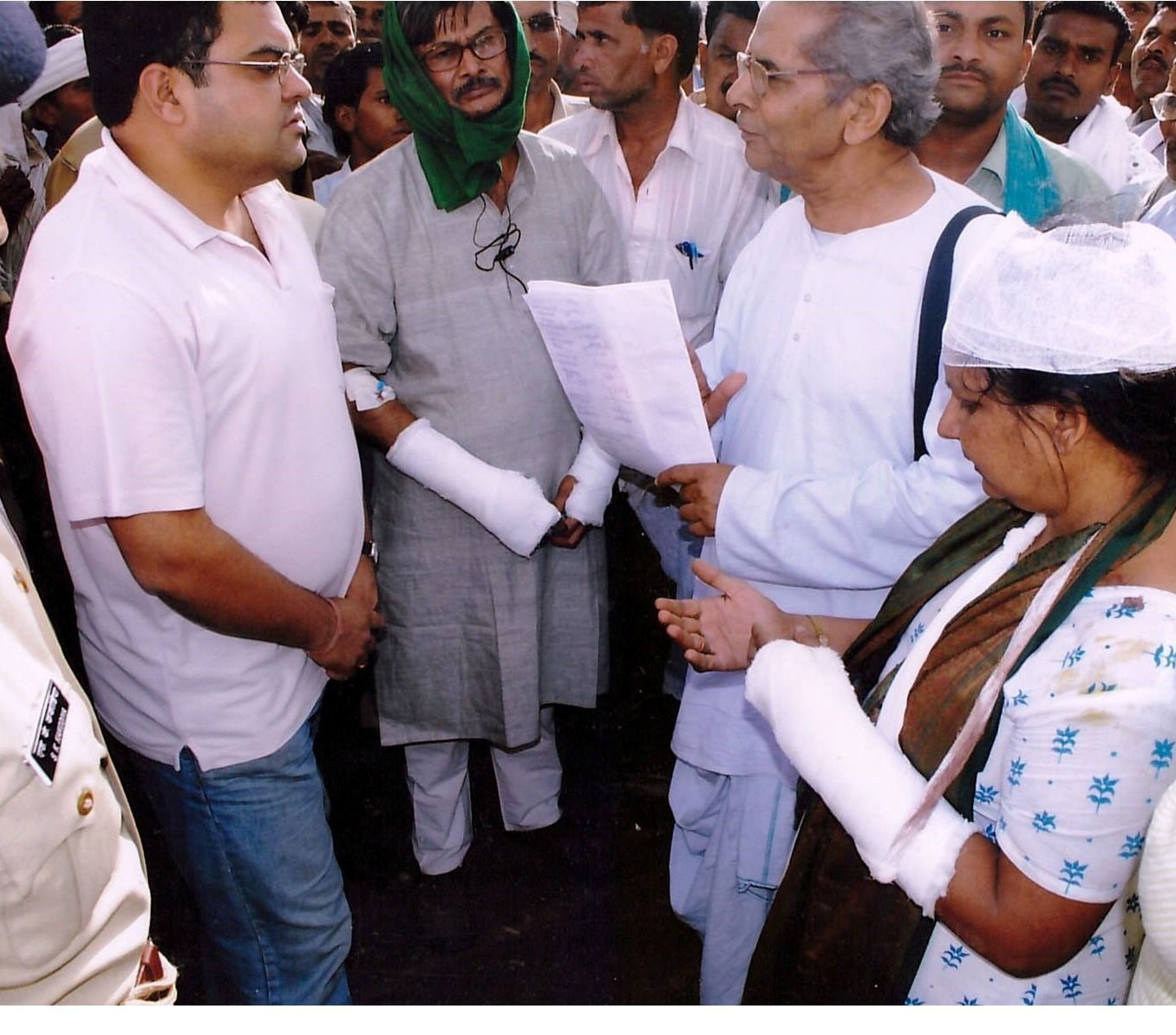 Protest leaders, including Aradhana Bhargav, confront a state official in the days after being assaulted in 2010. Image courtesy KSS