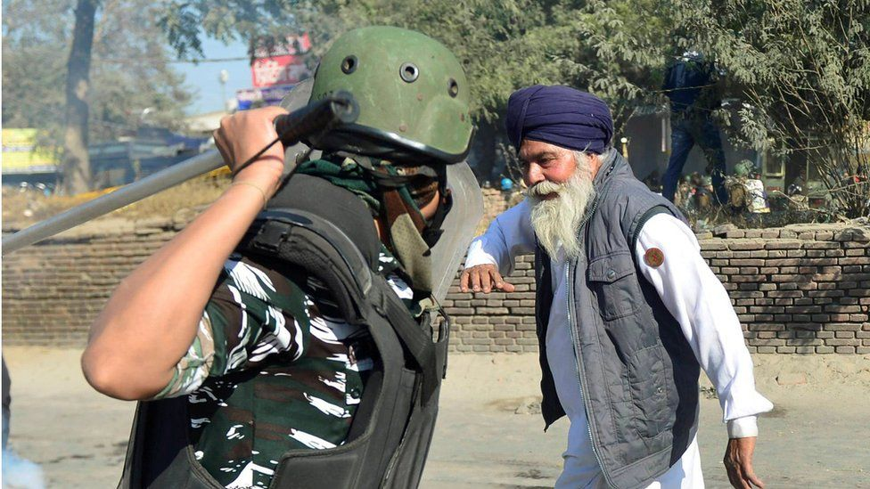 An image that went viral - paramilitary about to strike protesting farmer.  Photo Ravi Choudhary