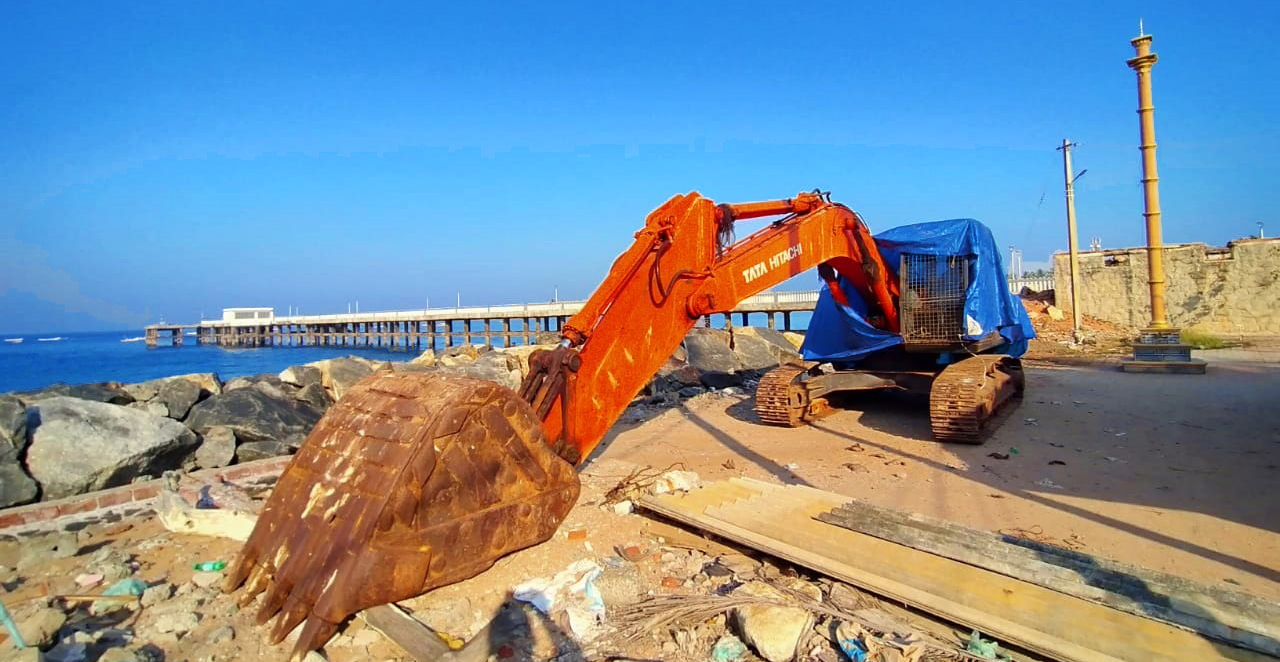 An excavator engaged in government attempts to stabilise the eroding coast near Vizhinjam