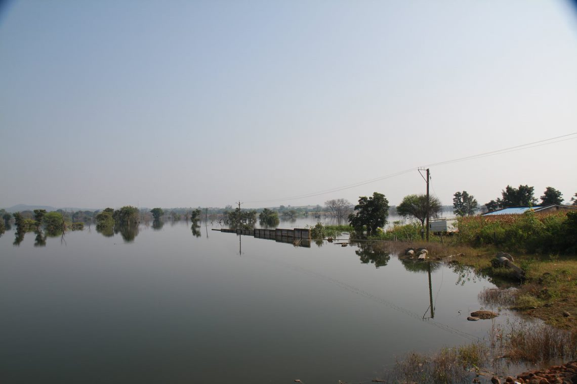 Floodwaters from an irrigation scheme partially immerse the boundary wall of the site for the Pench coal-power project, which is supposed to be at least 500 metres distant from floodplains and rivers. Image Ankit A.