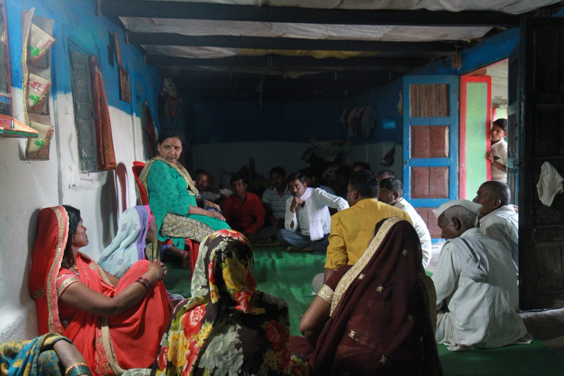 Advocate Aradhana Bhargav and the local community discuss concerns about the power project. Image by Ankit Agarwal