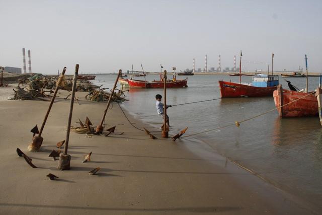 Fishing boats at Mundra - livelihoods degraded by destruction of coastal mangroves, mud flats by Adani Ports
