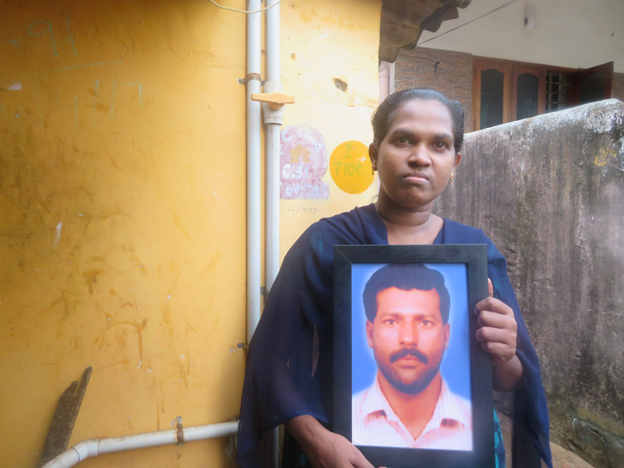 The widow of fisherman Joseph, who drowned when his boat capsized at the mouth of Vizhinjam fishing harbour in May 2021