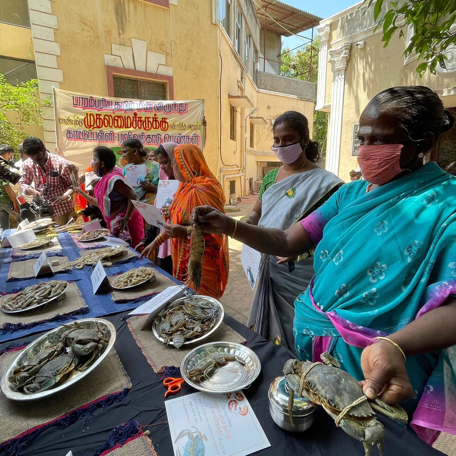 Tamil women organise a seafood feast for Chief Minister after pledge to save coast from Adani's port development.