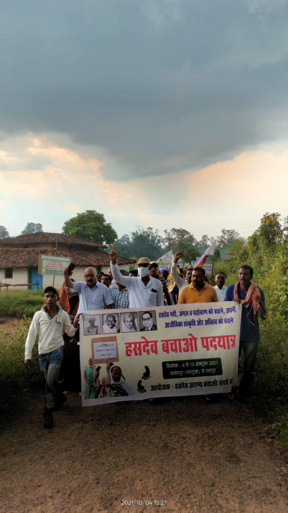 Marching despite stormy conditions to save the Hasdeo forests from coal mining. Image Twitter / @SaveHasdeo