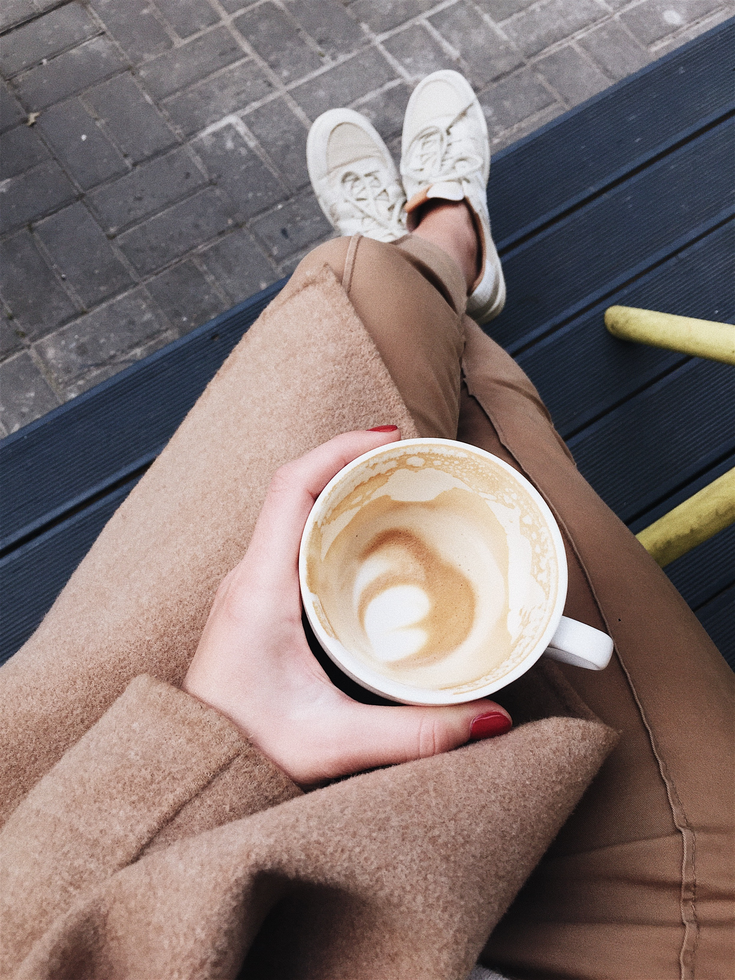 person-holding-coffee-cup-1841126.jpg