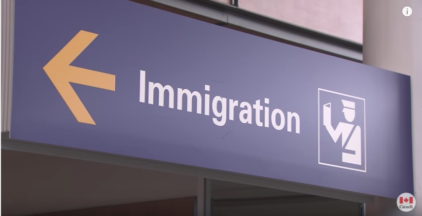An Immigration sign in an airport