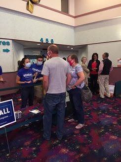For_website_Kendall_Qualls_campaign_team_handles_signs_Sheila_speaks_with_Lew_and_Sandra_Coffey.jpg
