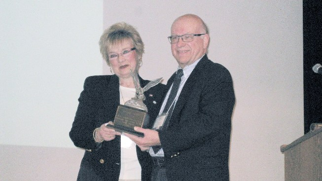 Barb_Sutter_receives_Crystal_Eagle_award.JPG