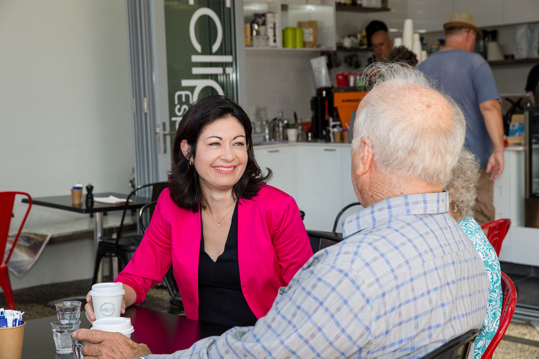 Terri Butler MP chatting about community issues over coffee