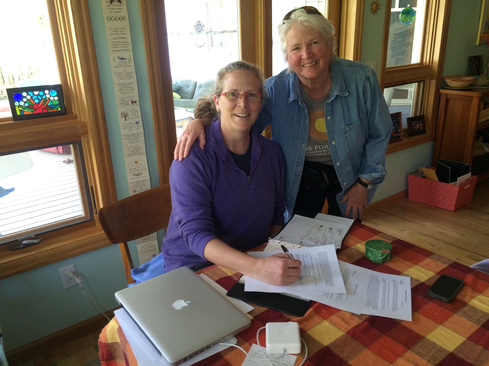 Julie & Martha signing the contracts