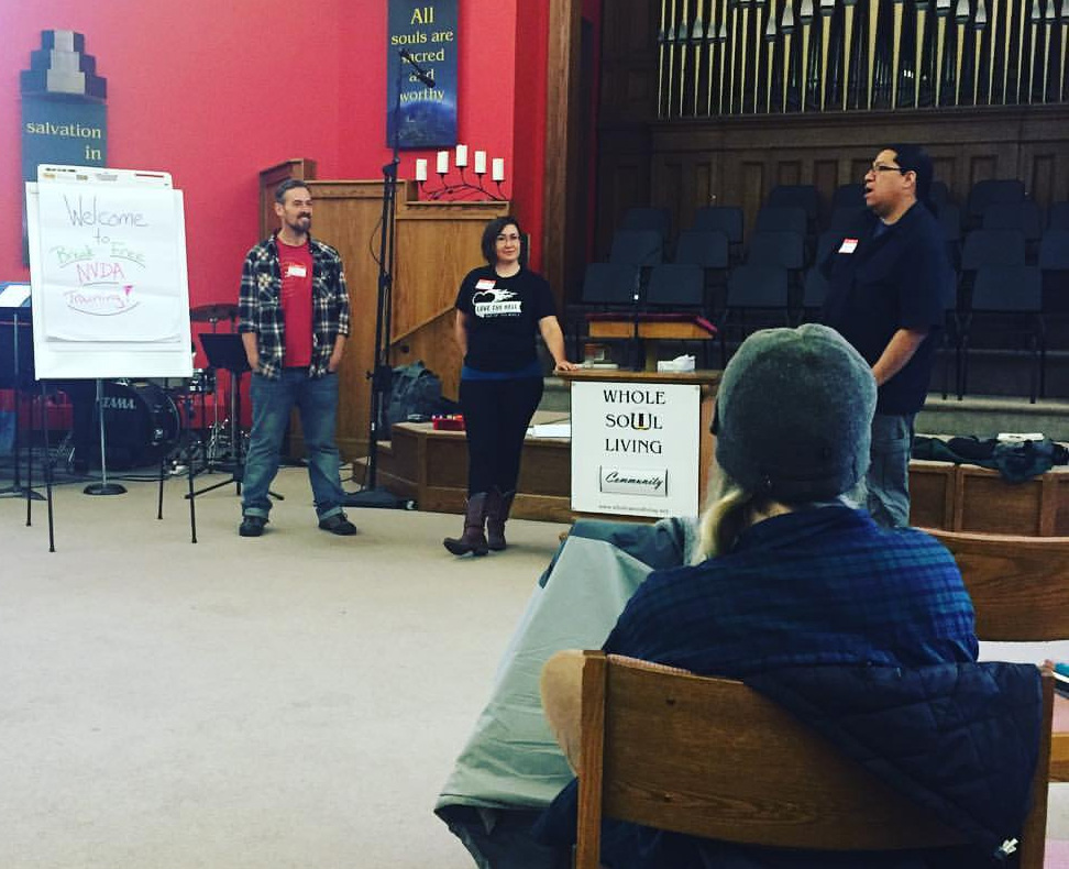 Pictured are the trainers of a non-violent direct action training at the First Unitarian Society of Denver