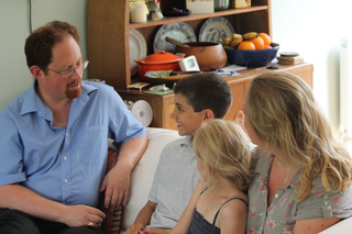 Julian speaking with a local family