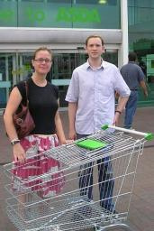Councillor Bruce and local resident Steven Cooper with a shopping trolley outside ASDA