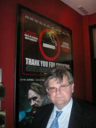 David standing in front of poster for the lobbying movie 'Thank You for Smoking'