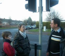 Clare Bartlet and son and Alan Levy at the traffic lights