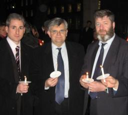 Greg Mulholland, David Howarth and Alistair Carmichael hold candles at the vigil