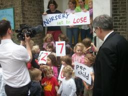 David accepts petition from nursery's toddlers