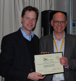 Tim Bick collect Leader's Award from Nick Clegg