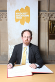Julian Huppert signing Holocaust Book of Commitment