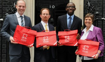 Julian joins Fabrice and MPs Justin Tomlinson and Julie Hilling at 10 Downing Street to hand in the petition.