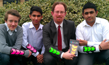 Julian and Netherhall School pupils with their invention