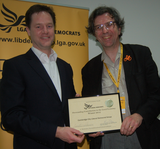 Colin Rosenstiel accepts Lib Dem award from Nick Clegg