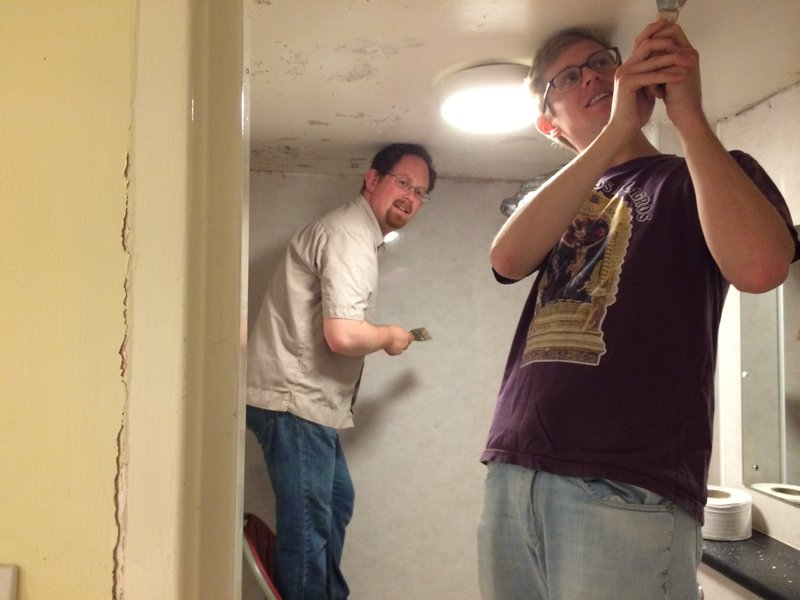 Julian Huppert helps decorate a shower block at Cambridge's Wintercomfort centre for the homeless