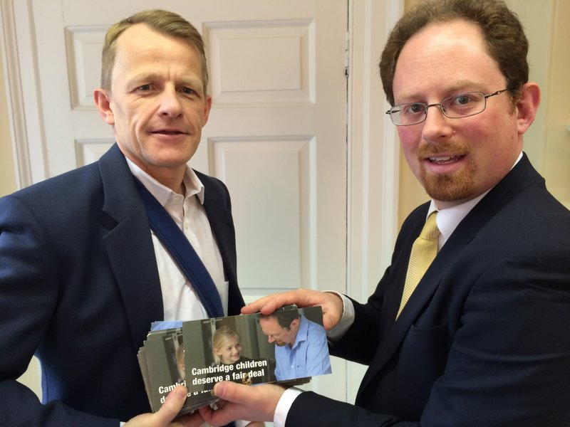 Julian Huppert hands petitions to Lib Dem Schools Minister David Laws