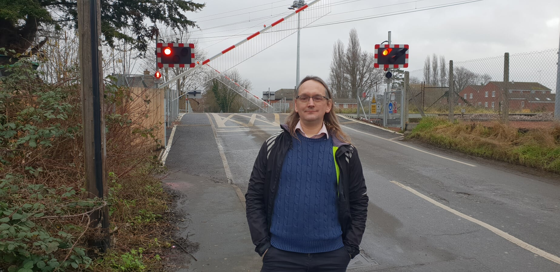 Owen Dunn in front of the level crossing