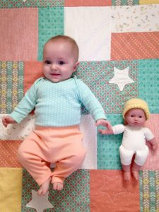 2-Baby-doll-wearing-her-Naomis-NICU-hat-225x300.jpg