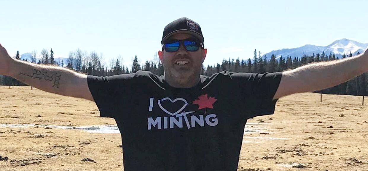 man wearing I love canadian mining tshirt