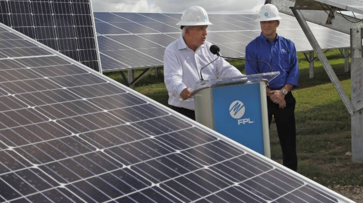 Florida Power & Light is asking for a $2 billion rate hike to fund infrastructure upgrades. An October 2018 file photo shows former Miami-Dade Mayor Carlos Gimenez with FPL President Eric Silagy. CARL JUSTE