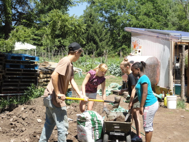 Student Employees Composting at Root 'N Roost Farm in White Sulphur Springs