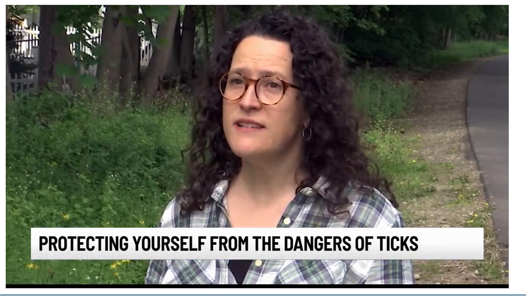 Katherine Nadeau, Deputy Director, standing in the woods