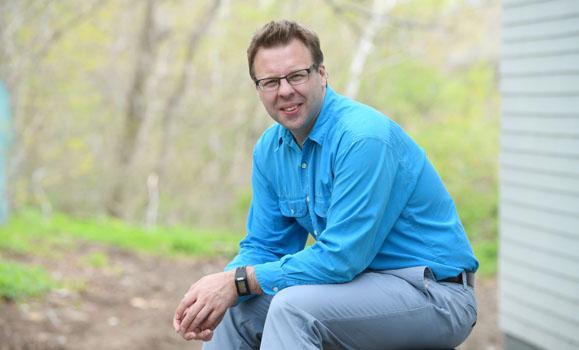 Author Phillip Joy sitting outdoors