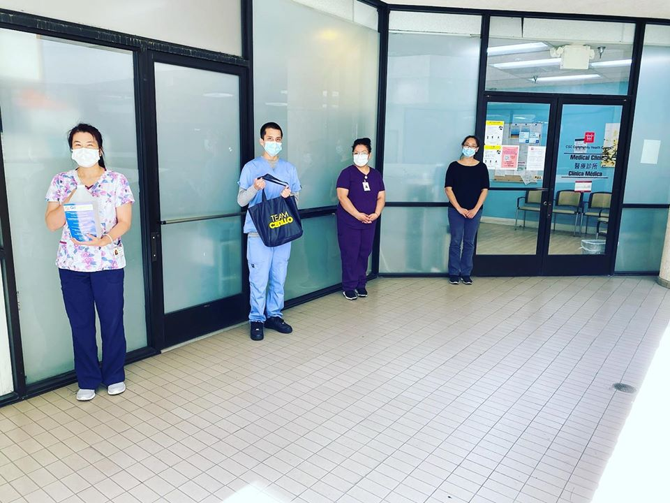 Chinatown Service Center Medical Clinic receiving hand sanitizer 5-6-2020