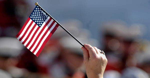 A hand holding US flag