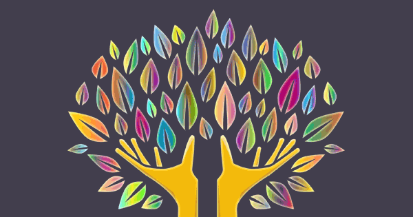 Two hands reaching for multi-colored leaves, in the shape of a tree