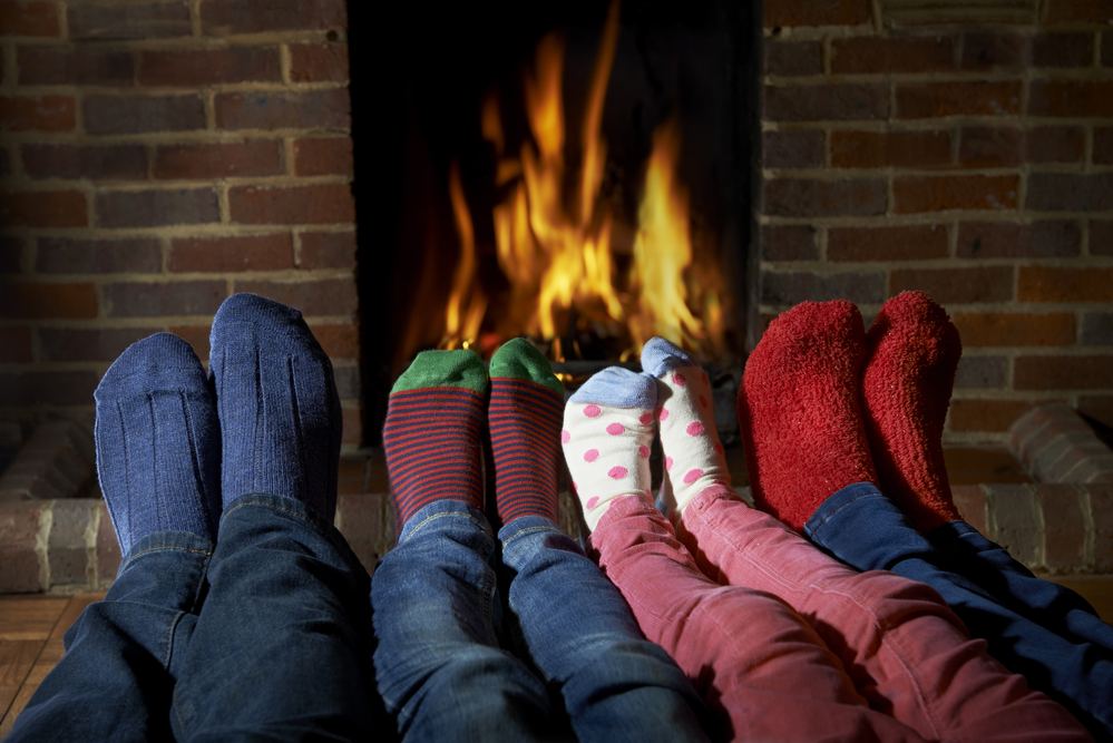 Family feet by the fire