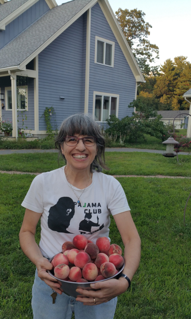 Charlene with peaches from her tree 2015