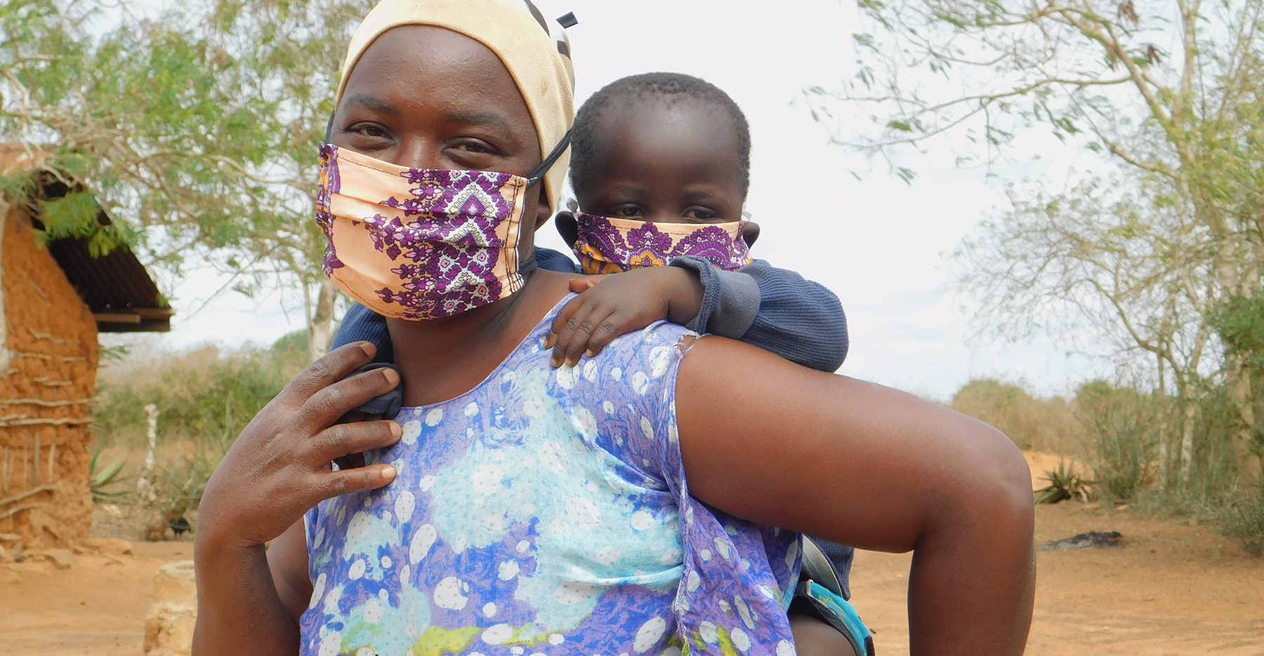 A mother and child in Kenya wear masks for COVID