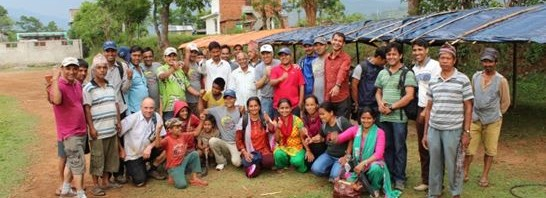 Volunteers-and-Staff-building-temp-schools-in-Nepal-546x198.jpg