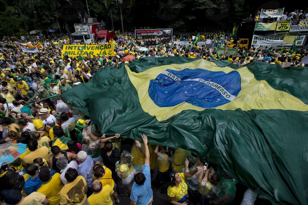 Protesters_in_Sao_Paulo_with_a_large_Brazilian_flag.jpg