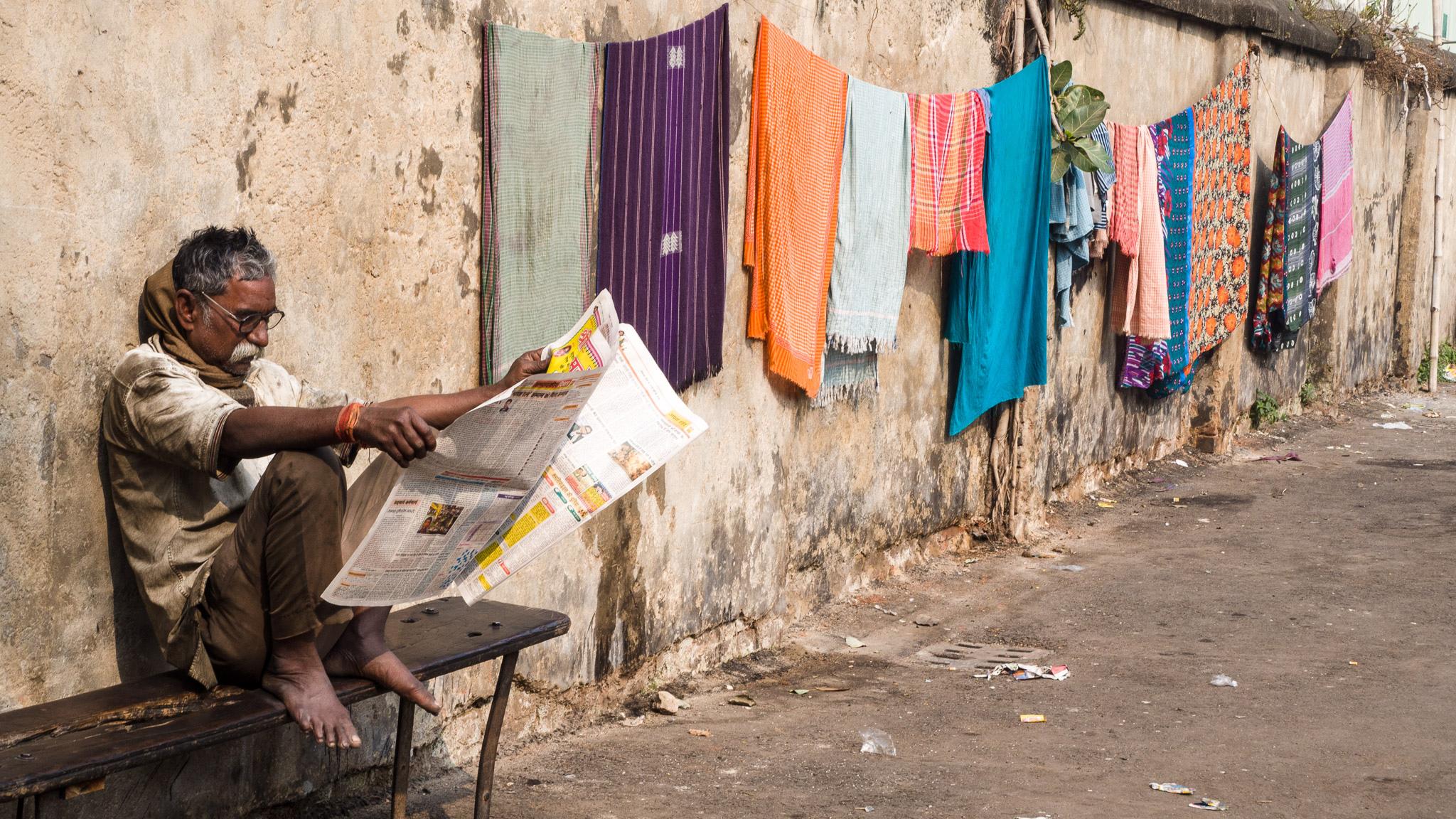 Man_Reading_Newspaper_in_India_Mike_Prince.jpg