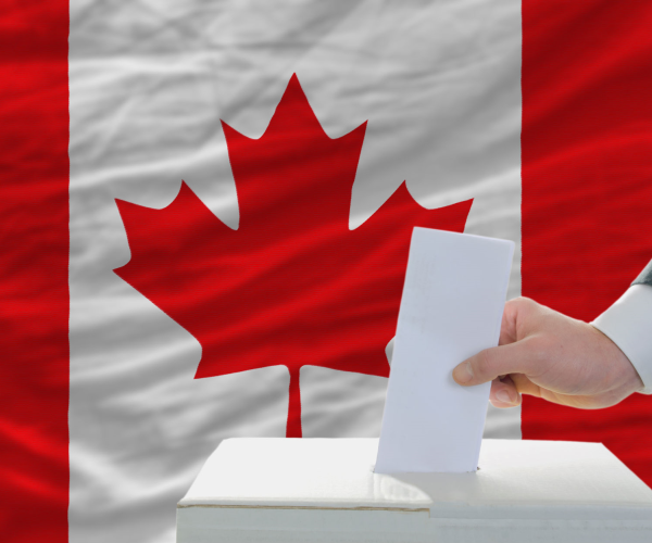 man-putting-ballot-in-a-box-during-elections-in-canada.png