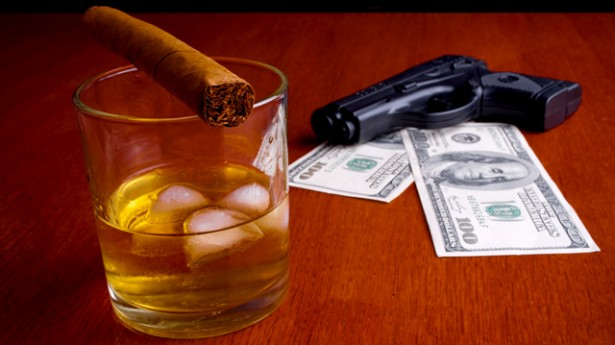 gun_smoking_money_shutterstock_93311092-615x345.jpg